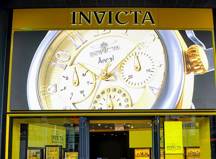 Invicta video display showing a gold watch