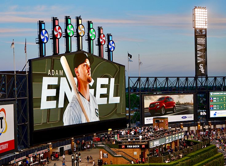 Large screen introducing a baseball player at a baseball game